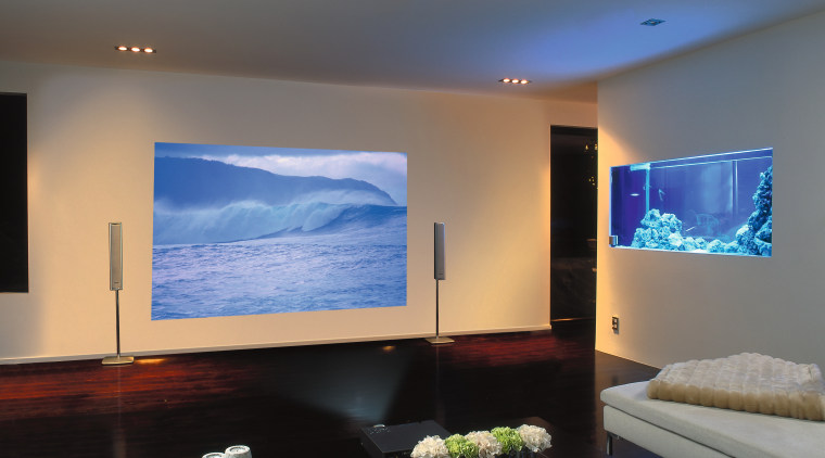 A photograph of a media room featuring a ceiling, display device, flat panel display, home, interior design, lighting, living room, multimedia, projection screen, room, gray
