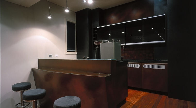A view of a bar top with axolotl cabinetry, countertop, flooring, interior design, kitchen, lighting, room, black