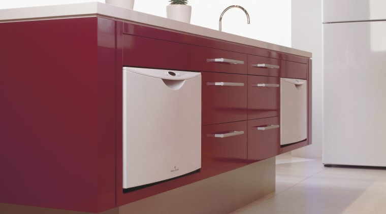A contemporary-style kitchen with white appliances bathroom accessory, bathroom cabinet, cabinetry, chest of drawers, countertop, drawer, furniture, kitchen, product, product design, sideboard, sink, tap, white, red