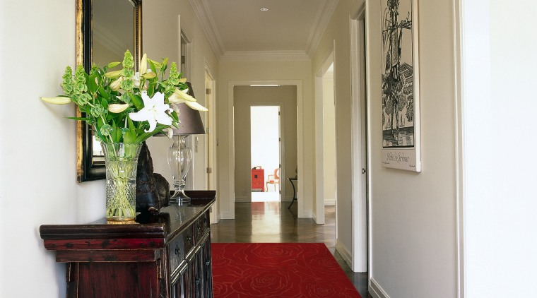 View of the hallway containing a wool rug ceiling, estate, floor, flooring, hall, hardwood, home, house, interior design, living room, property, real estate, room, wall, gray