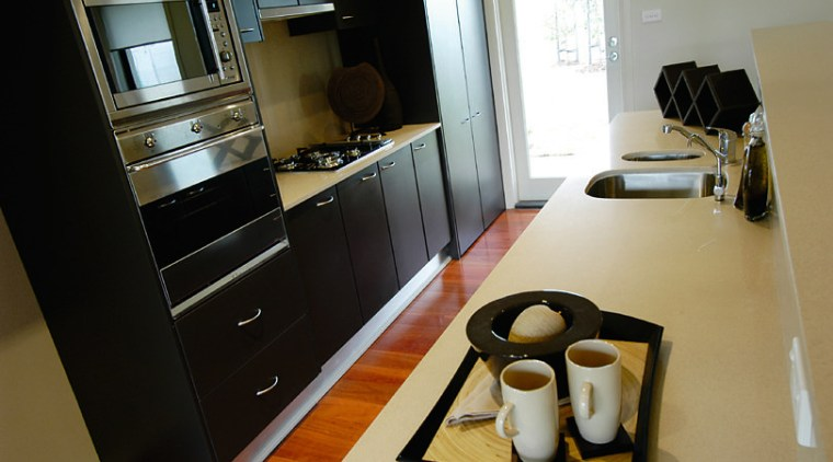 View of the kitchen countertop, furniture, home appliance, interior design, kitchen, room, black