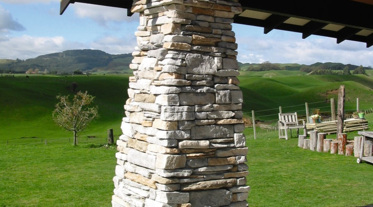 Close view of the stone column made by outdoor structure, white