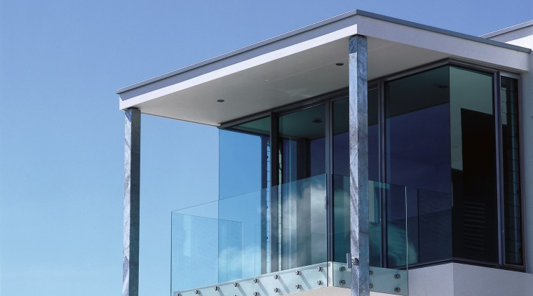 Overall view of the balcony architecture, facade, glass, house, window, teal