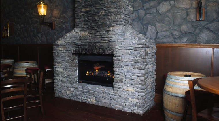 View of the fireplace fireplace, floor, flooring, hearth, home appliance, masonry oven, wall, wood burning stove, black