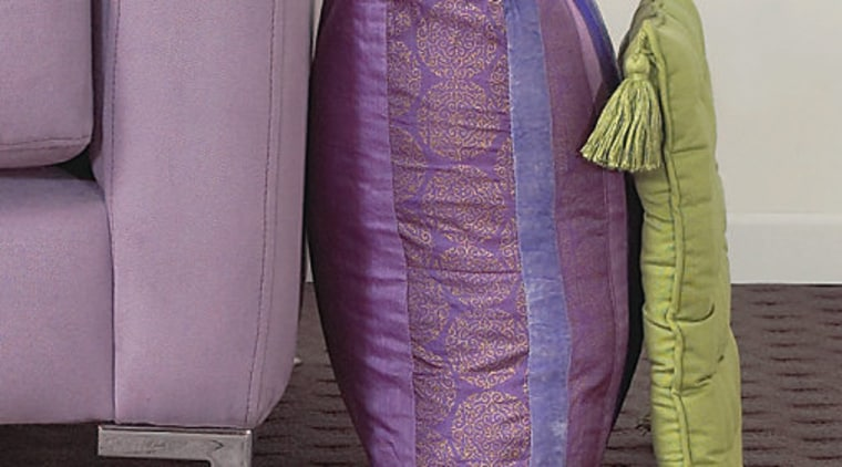 A photograph of the side of a sofa car seat cover, chair, couch, furniture, product design, purple, violet, gray