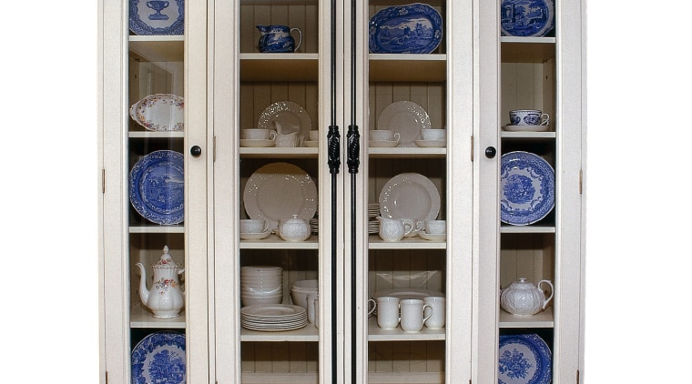 A photograph of a large cabinet with chinaware china cabinet, cupboard, display case, furniture, shelving, white
