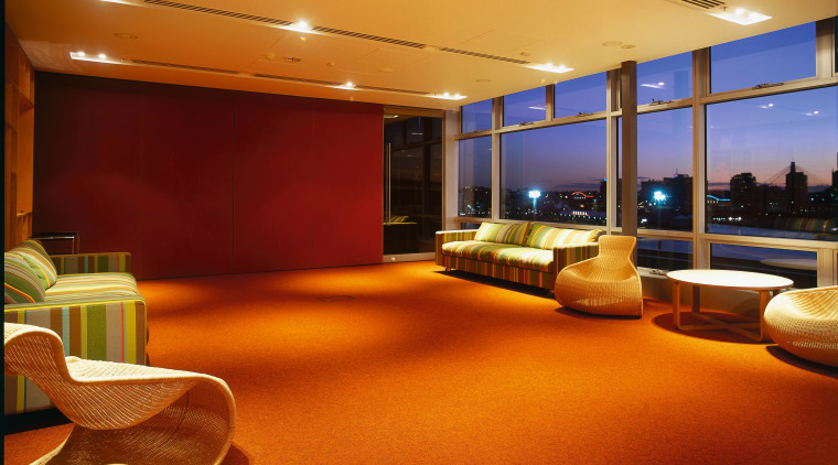 Office meeting room with striped couches and cane ceiling, interior design, lighting, lobby, brown
