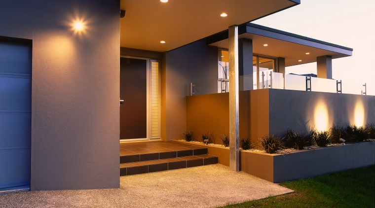 View of the front entrance of this modern architecture, elevation, estate, facade, home, house, interior design, lighting, property, real estate, residential area, siding, window, brown
