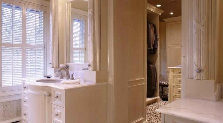 Interior view of bathroom bathroom, bathroom accessory, bathroom cabinet, cabinetry, countertop, floor, flooring, home, interior design, room, sink, window, brown, gray