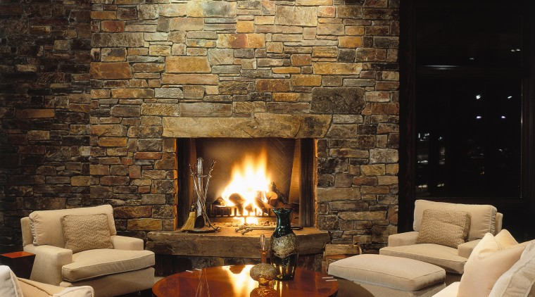 View of the living area, stone fireplace, stone ceiling, fireplace, hearth, home, interior design, lighting, living room, lobby, wall, wood burning stove, black, brown