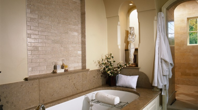 Large bath with limestone surround, brick lined archway, bathroom, bathtub, ceiling, countertop, estate, floor, flooring, home, interior design, room, sink, brown