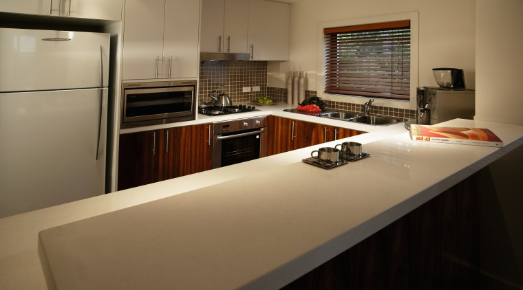 Kitchen with white coloured quarz benchtop, timber cabinetry countertop, interior design, kitchen, real estate, room, brown