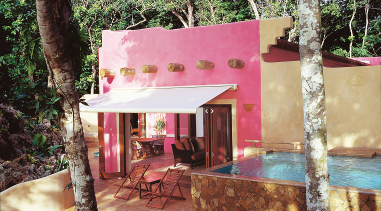 Pink coloured hotel room with awning over outdoor cottage, hacienda, home, house, property, real estate, resort, black