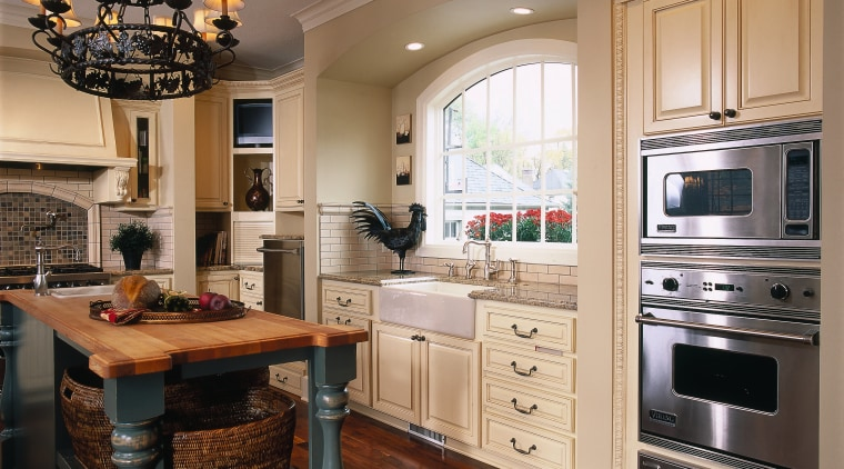 View of the kitchen, wooden flooring, cabinetry and cabinetry, countertop, cuisine classique, flooring, hardwood, home appliance, interior design, kitchen, room, black, brown