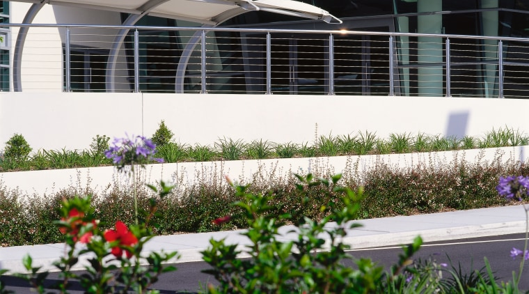 Gardens in front of building complex, with white garden, house, outdoor structure, plant, real estate, window