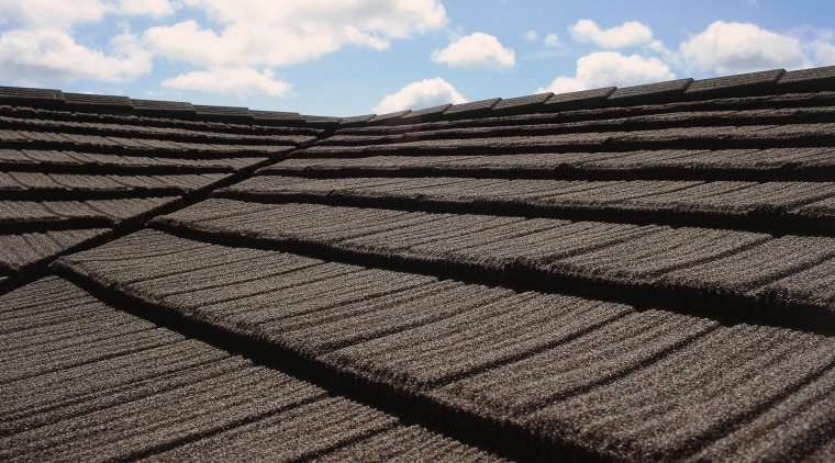 Closeup of textured finish on roofing. cloud, daylighting, field, line, meteorological phenomenon, outdoor structure, roof, sky, soil, sunlight, wood, black, white