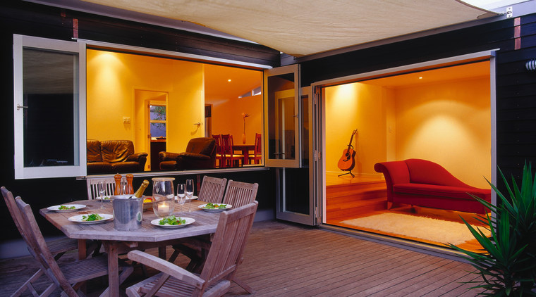 Decking area of black house with bifold doors home, interior design, living room, real estate