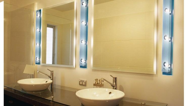 Bathroom with twin white round basins on dark bathroom, bathroom accessory, interior design, lighting, plumbing fixture, product design, room, sink, orange