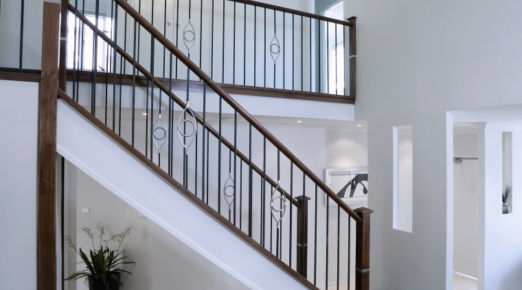 Open stairwell with ornate balustrades, white walls and architecture, baluster, ceiling, daylighting, estate, handrail, home, house, interior design, real estate, stairs, wall, gray
