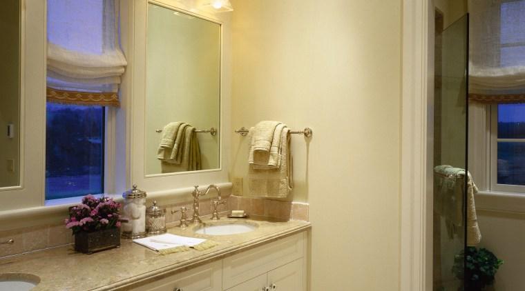 View of a bathroom, off-white tiled flooring, white bathroom, bathroom accessory, bathroom cabinet, cabinetry, ceiling, countertop, floor, home, interior design, kitchen, lighting, room, sink, brown, orange