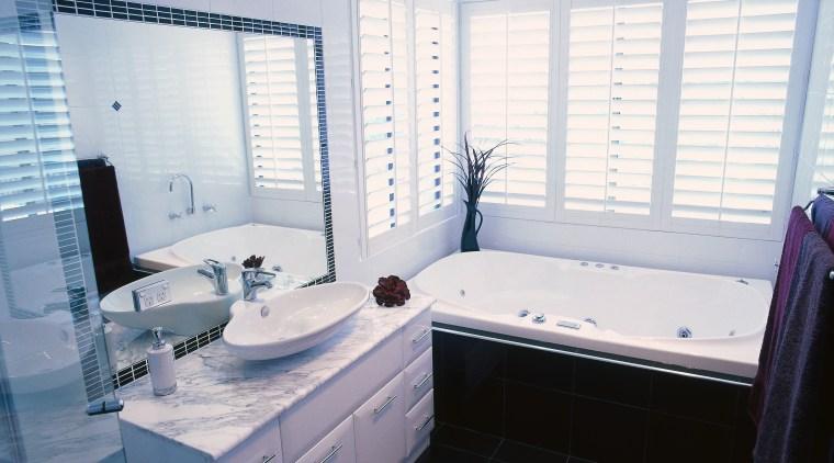 Bathroom with white wall tiles, black floor tiles bathroom, bathtub, floor, home, interior design, property, room, window, white, gray