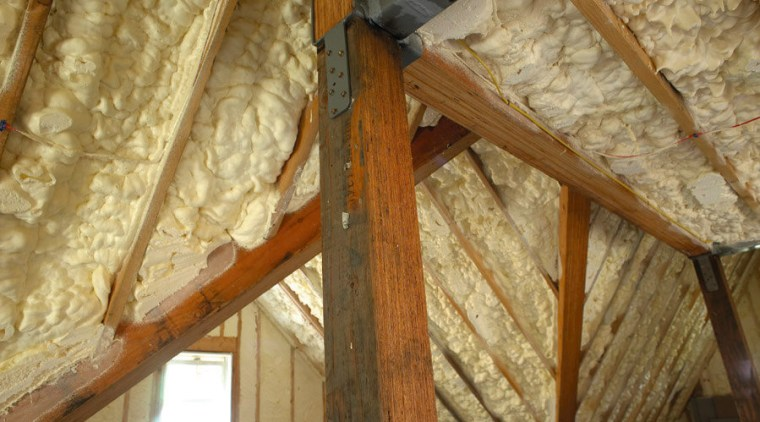 View of the Icynene insulation in the roof. attic, beam, building insulation, ceiling, log cabin, lumber, roof, wood, brown