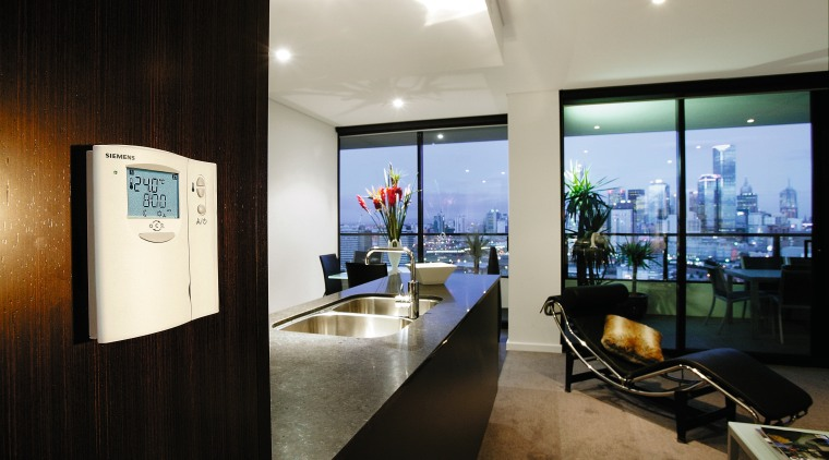 Open plan kitchen and lounge area with climate interior design, real estate, black, gray