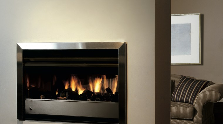 view of the fireplace situated in the walling fireplace, hearth, heat, home appliance, wood burning stove, gray, black