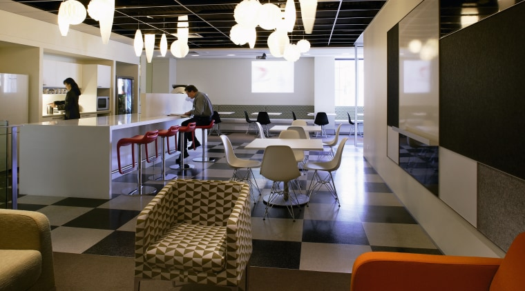 A view of the breakout area, green, brown furniture, interior design, office, restaurant, table, brown