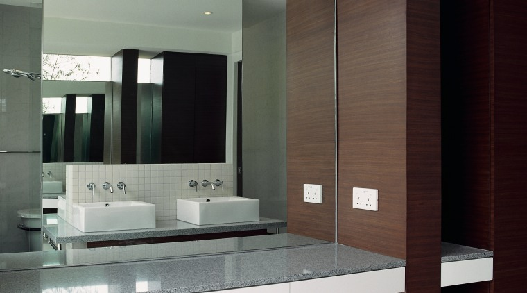 view of the mirrored walls that increase the interior design, gray
