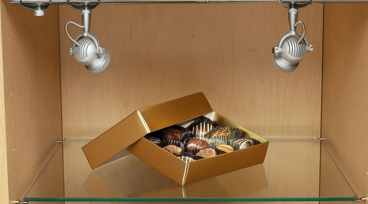 View of a choclate box on a gass furniture, product, product design, shelf, table, brown, orange