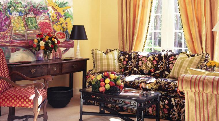 View of a living area, cream carpet, wooden furniture, home, interior design, living room, room, table, window, orange