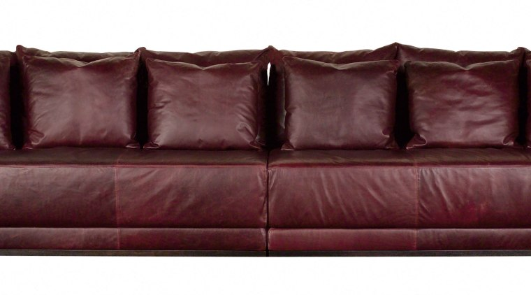 View of a very long, square brown leather couch, furniture, loveseat, sofa bed, red, white