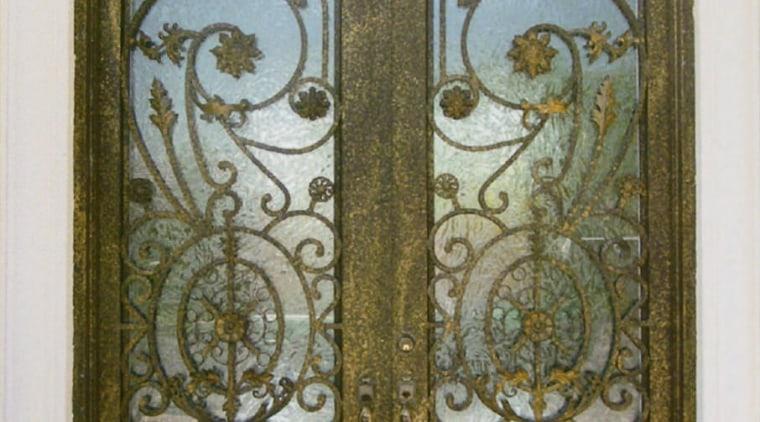 Close up view of a wooden door with door, glass, iron, metal, brown, gray