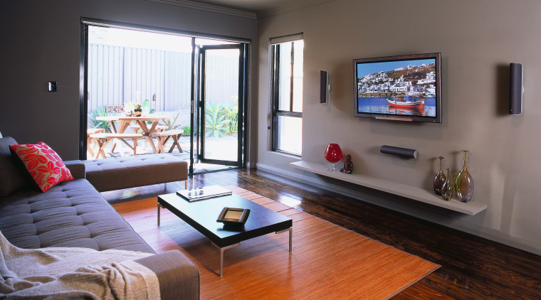 view of the lounge and home/audio entertainment system floor, flooring, hardwood, home, interior design, living room, property, real estate, room, window, wood, gray, black