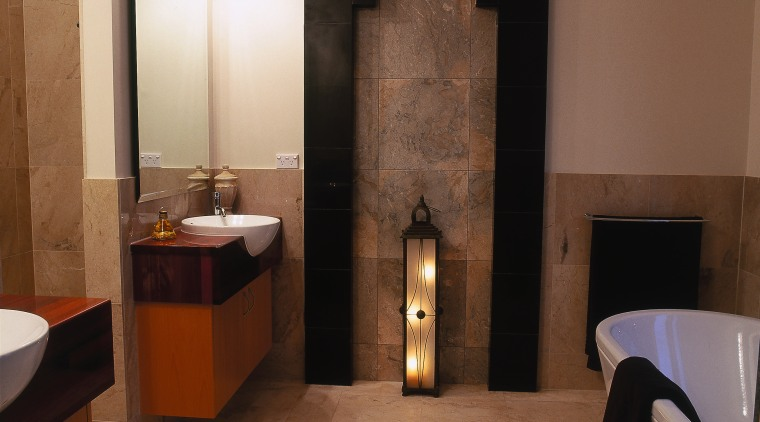 view of the bathroom featuring acid etched marble bathroom, ceiling, floor, flooring, interior design, lobby, room, tile, wall, brown
