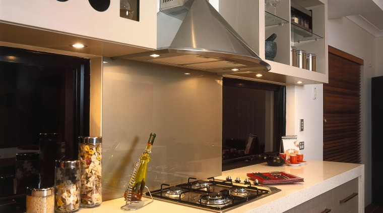 A view of a kitchen, wooden flooring, cream countertop, cuisine classique, interior design, kitchen, room, under cabinet lighting, gray, black