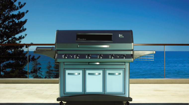 A view of a large steel BBQ in daylighting, teal, blue