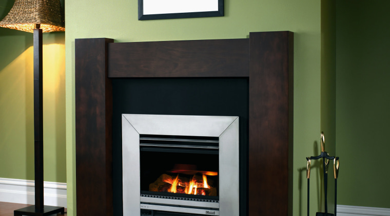 A view of an inbuilt fireplace with wooden fireplace, hearth, heat, home appliance, wood burning stove, black