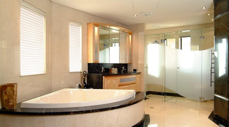 view of the bathroom showing tiled flooring , bathroom, ceiling, floor, interior design, kitchen, real estate, room, window, orange, white