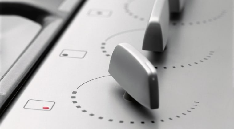 A close up view of the knobs on automotive design, font, product design, technology, white, gray