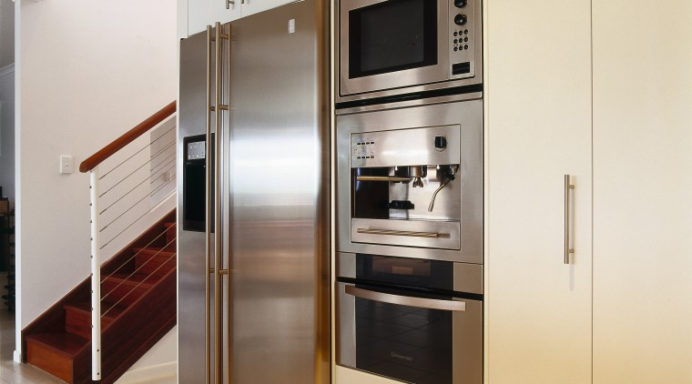 view of this kitchen featuring kleenmaid fridge,oven, microwave countertop, home appliance, kitchen, kitchen appliance, kitchen stove, major appliance, refrigerator, white