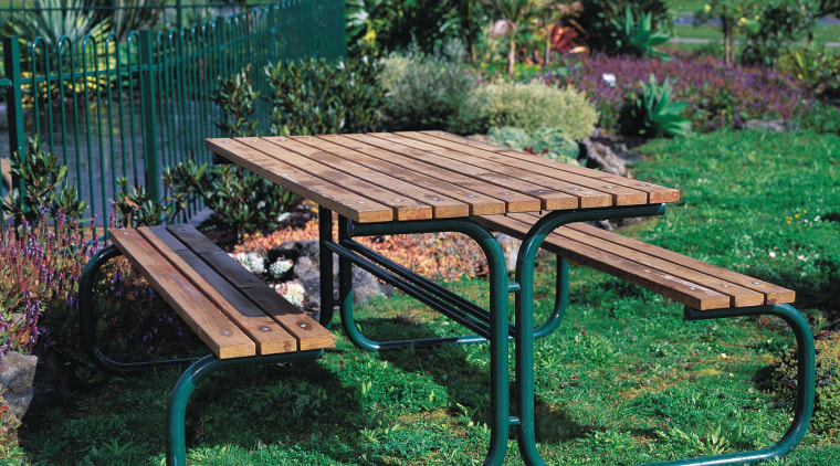 Timber and tubular steel outdoor table and chairs. backyard, bench, furniture, garden, outdoor furniture, outdoor structure, table, yard, green, black