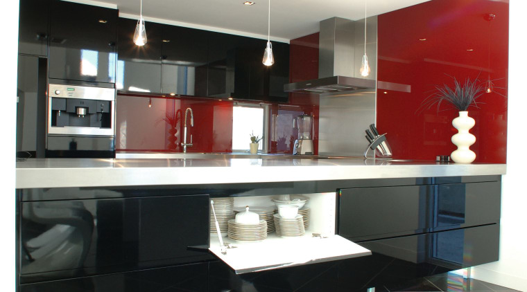 Kitchen with lacquered black cabinetry and bright red architecture, countertop, floor, flooring, furniture, interior design, kitchen, living room, product design, table, white, black