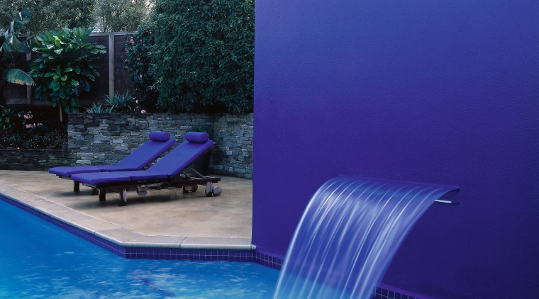 Pool with large royal blue feature wall and backyard, blue, leisure, light, lighting, reflection, swimming pool, water, water feature, water resources, blue