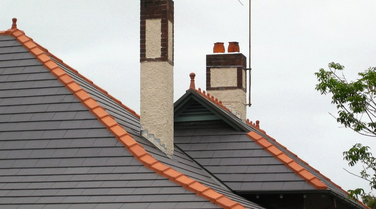 view of the ceramic tiles from nu-lok roofing building, chimney, facade, roof, sky, white, gray