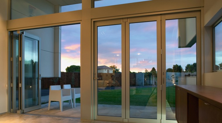 view of these bifold doors that open out door, glass, interior design, real estate, window, brown