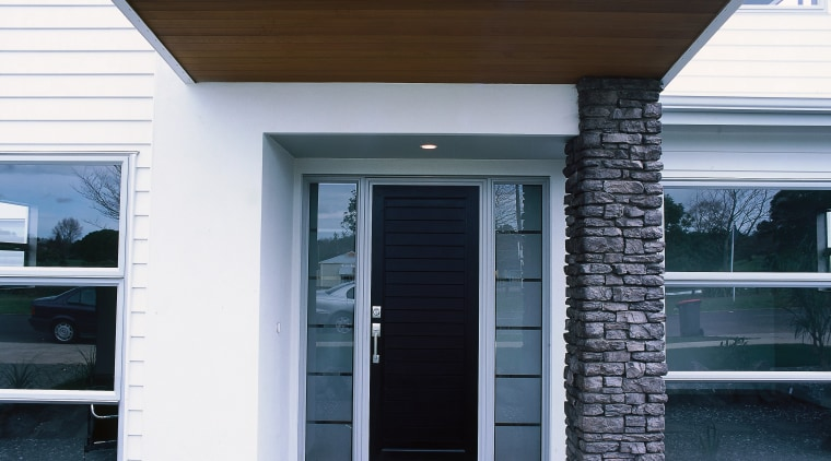 view of this contemporary jalcon show home featuring door, facade, home, house, real estate, siding, window, white