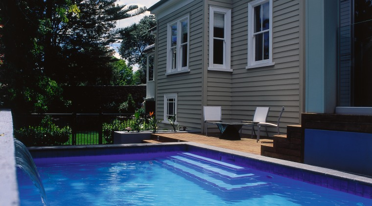 Images of a pool with a water feature, backyard, estate, home, house, outdoor structure, property, real estate, reflection, residential area, siding, sky, swimming pool, villa, water, teal, black