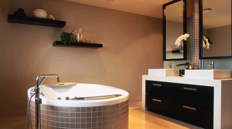 A view of a bathroom, tiled floor, brown bathroom, floor, flooring, interior design, room, brown, orange